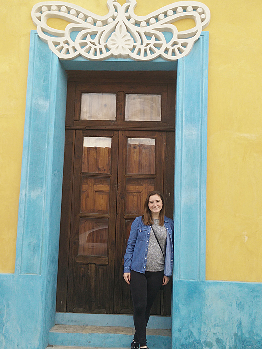 Pretty doorway and pretty occupant!